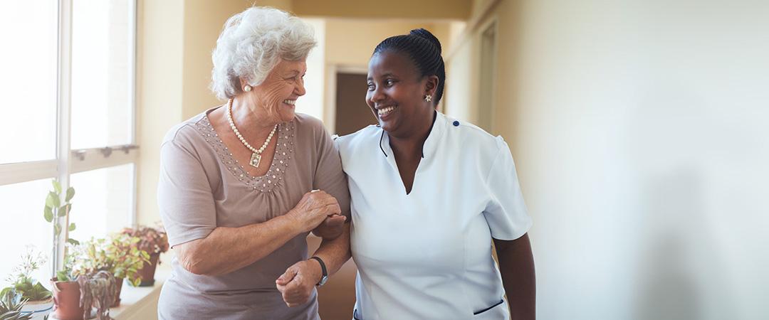 Female Nurse Helping Elderly Women