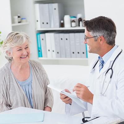 Elderly Women Smiling Through Her Checkup