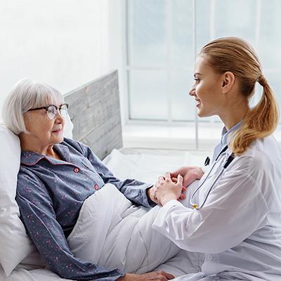 Nurse Helping Elderly Women