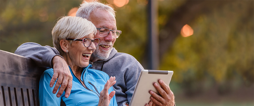 Elderly Man and Women Skyping a Loved one