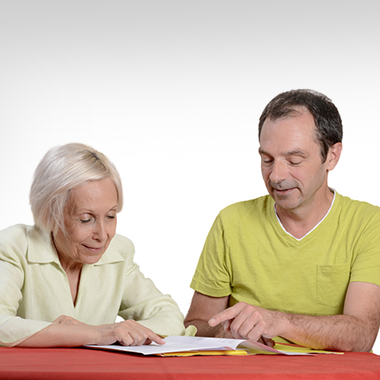 therapist pointing out words for resident to read during therapy