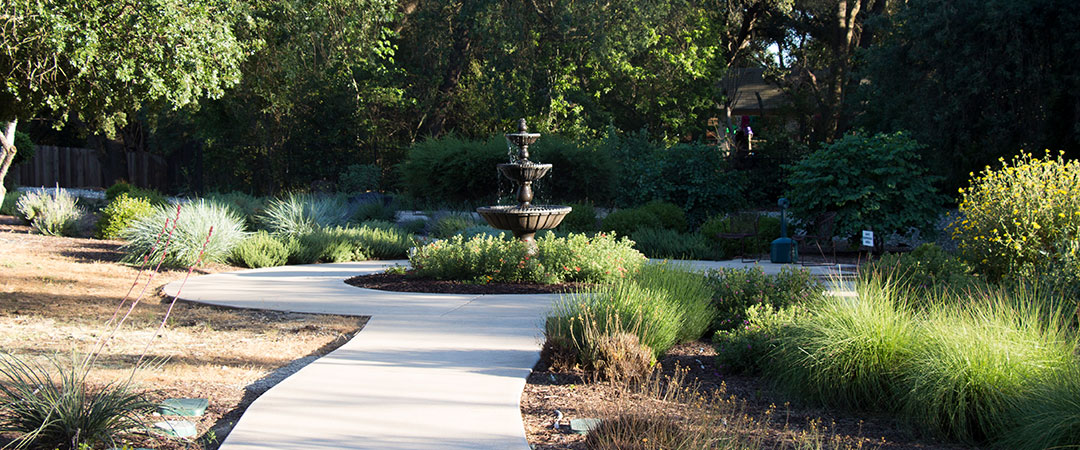 A fountain on the peaceful grounds of Quiescence along a walking path