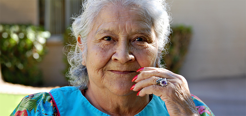 A woman outside smiling.